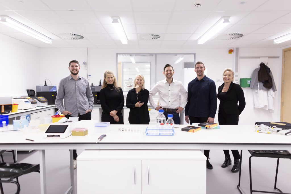 The Forth team stood in a lab