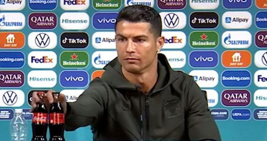 Christiano Ronaldo removes Coca Coca bottles from press conference table